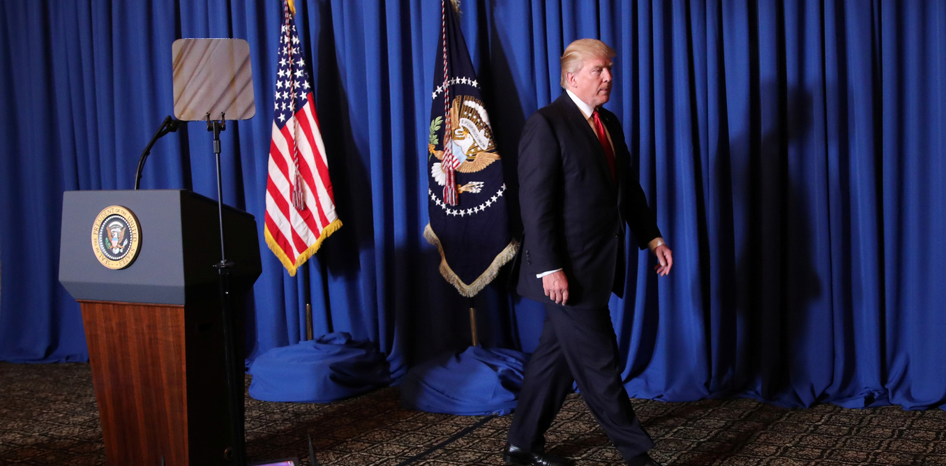 U.S. President Donald Trump leaves after delivering a statement about missile strikes on a Syrian airfield, at his Mar-a-Lago estate in Palm Beach, Florida, U.S., April 6, 2017. REUTERS/Carlos Barria - RTX34H6H
